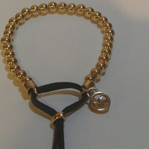 MK Gold beaded bracelet w leather tassel